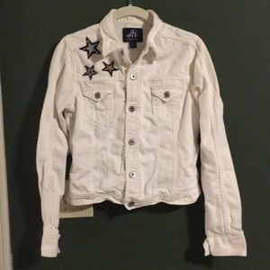 White jean jacket with star appliqué